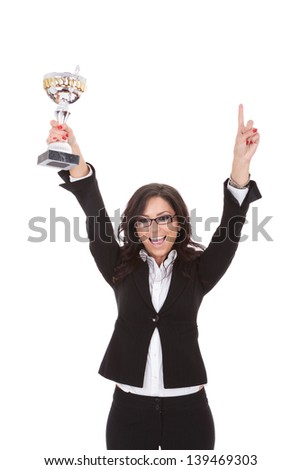 young business woman cheering with a trophy in her hand, happy to be number one . on white background