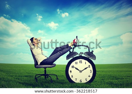 young business woman corporate executive relaxing sitting on a chair in the open air outdoors