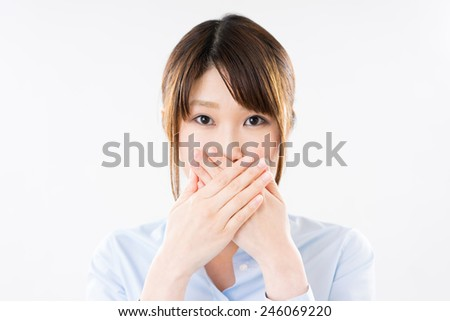 young business woman covering her mouth - stock photo