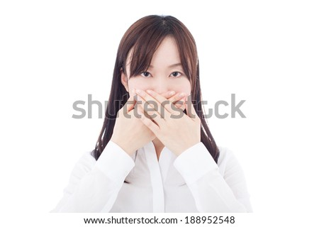 young business woman covering her mouth, isolated on white background  - stock photo