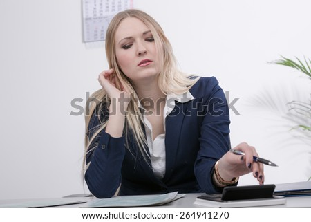young business woman desperate at work - stock photo