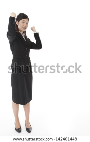 young business woman doing a guts pose