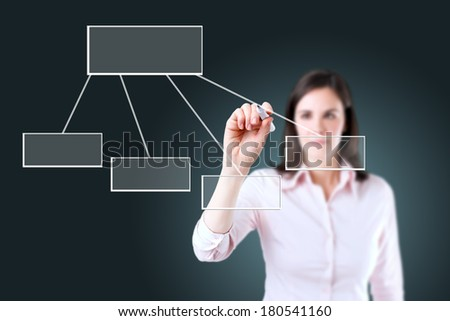 Young business woman drawing a flowchart 1. - stock photo
