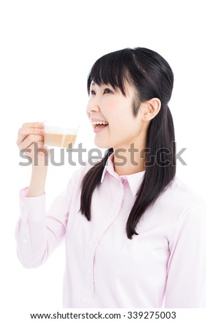young business woman drinking coffee isolated on white background