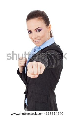 young business woman fighting with you - en garde position - stock photo