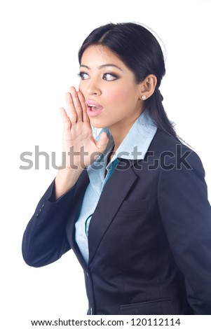 Young business woman gesturing, whispering on white background - stock photo
