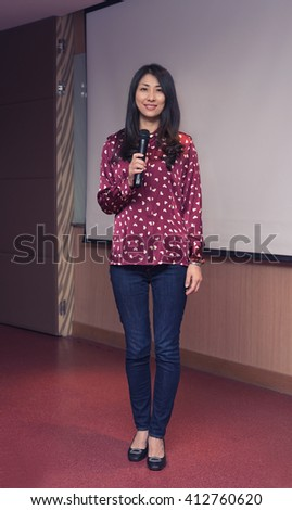 Young business woman giving a presentation - stock photo