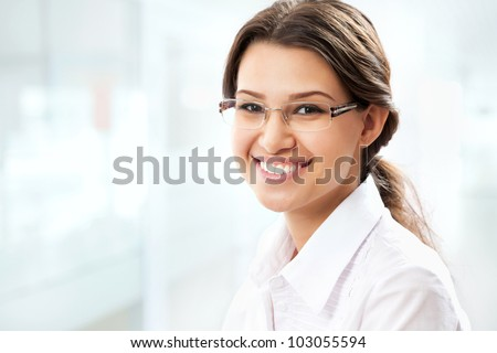 Young business woman giving you attractive smile - stock photo