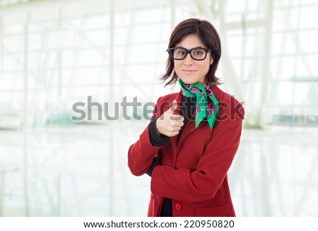young business woman going thumb up, at the office - stock photo