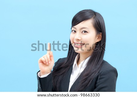 young business woman having an idea, isolated on blue background