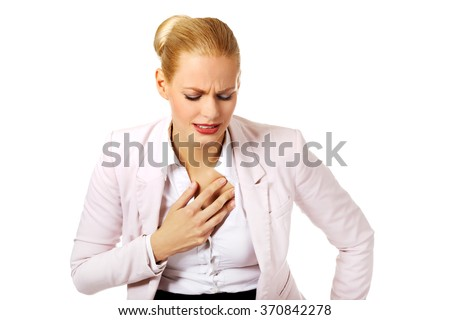 Young business woman having heart disease - stock photo