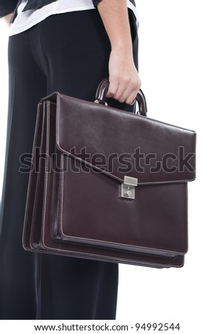 young business woman holding a briefcase - stock photo
