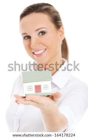 Young business woman holding a house on her palm. Isolated on white. - stock photo