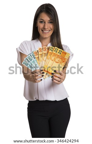 young business woman holding money - Brazilian money