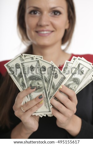 young business woman holding money. portrait of a beautiful girl holding money