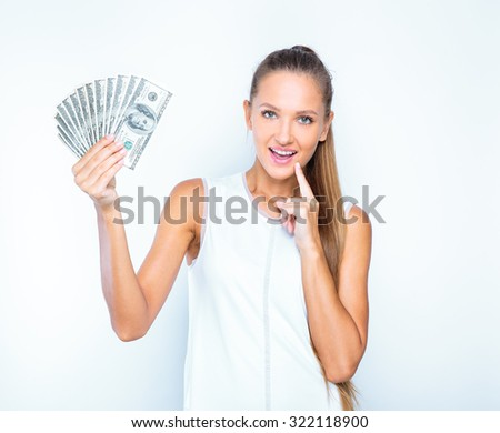 young business woman holding money. portrait of a beautiful girl holding money isolated on white background