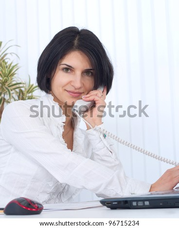 Young business woman holding the phone - stock photo