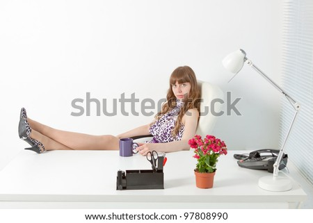young  business woman in a comfortable modern office - stock photo