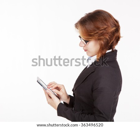 young business woman in black suit and glasses looking at the tablet display