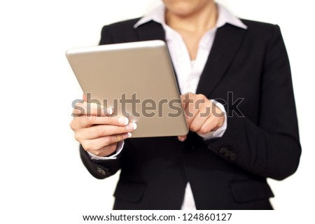 Young business woman in black suit using a digital tablet. Isolated on white background.