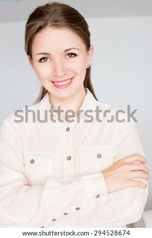 Young business woman in bright shirt smiling - stock photo