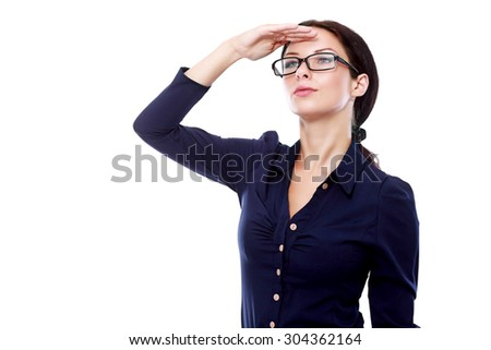young business woman in glasses looking far away cover her eyes from the sun, over a white background - stock photo