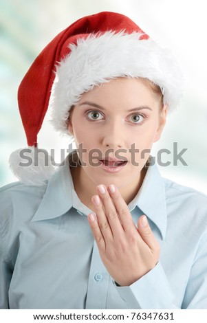 Young business woman in santa hat shocked - stock photo