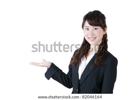 young business woman introducing something - stock photo