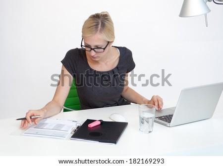 Young Business woman is smiling while working at work desk