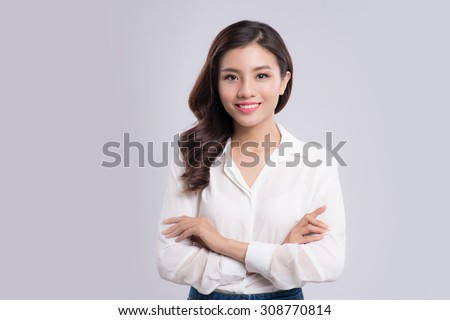 young business woman isolated on gray background - stock photo