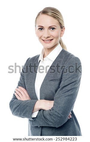 Young business woman keeping arms crossed