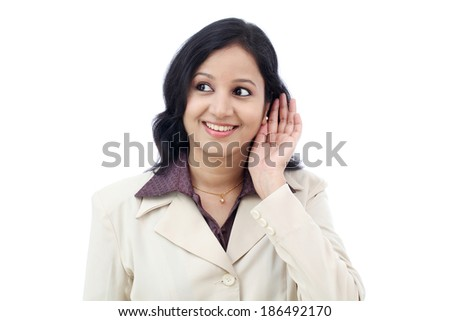 Young business woman listening against white background - stock photo