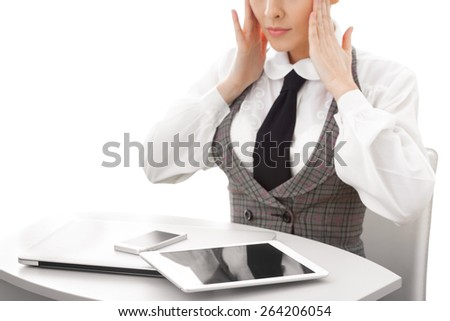 Young business woman looking at computer tablet pc smartphone feeling frustrated on white background. - stock photo
