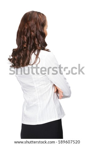 Young business woman looking at something in her back, isolated over white background - stock photo