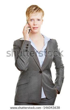 Young business woman making a phone call with her smartphone - stock photo