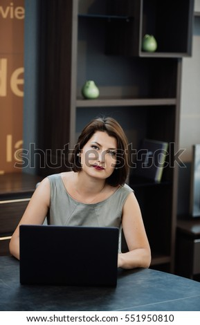 Young business woman on a laptop at her office.