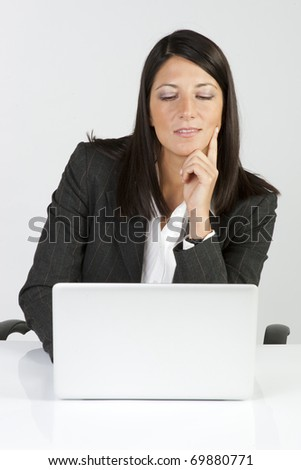 Young business woman on a laptop - isolated on white - stock photo