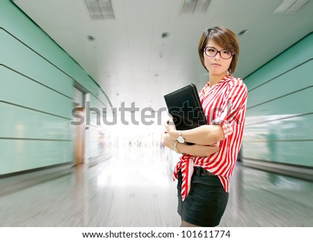 Young business woman on the background of a modern airport