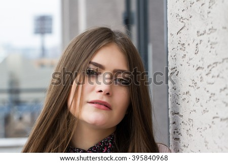 Young business woman on the background of office building