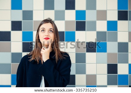 Young business woman or student thinking - stock photo