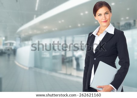Young Business woman over office background - stock photo