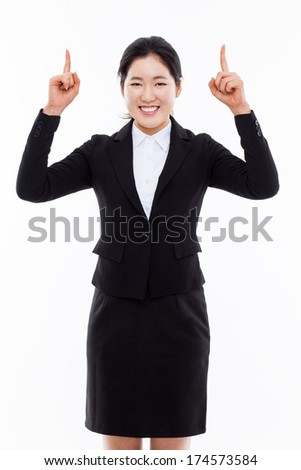 Young business woman point up side isolated on white background.
