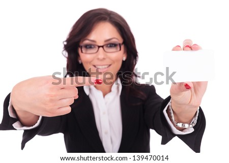 young business woman pointing at a blank card that she is holding. on white background - stock photo