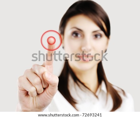 Young business woman pointing at something on screen - stock photo