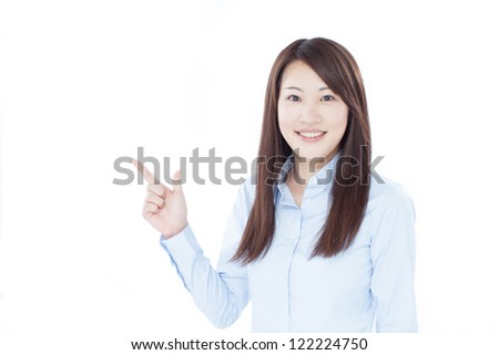 young business woman pointing copy space - stock photo