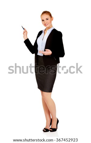Young business woman pointing for copyspace or board