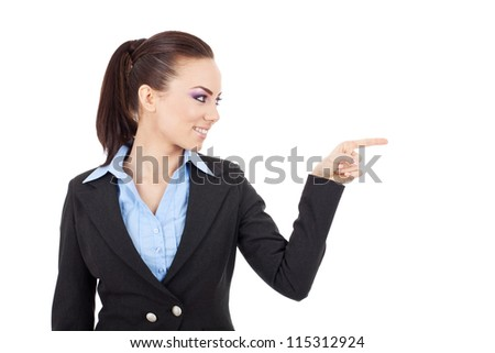 young business woman points and looks at something to her side. Isolated on white background - stock photo