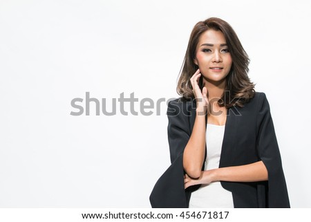 Young business woman posing,wearing formal suit isolated on white background.