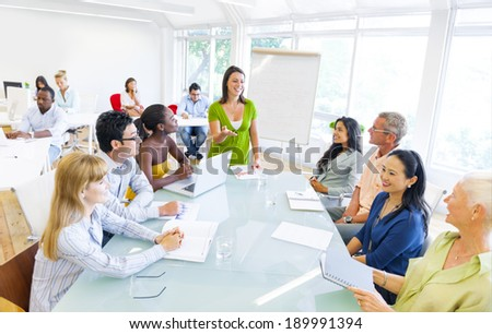 Young Business woman presenting to her colleagues