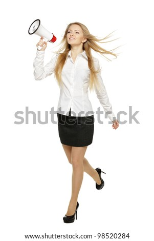 Young business woman running with megaphone, over white background - stock photo